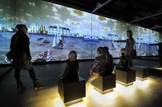 Projection and mirrored wall creates an immersive effect