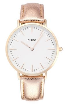 Loving this crackled metallic band that anchors an elegantly simple round watch with sharp hour markers. It's dazzling, yet understated.