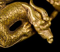 Scythian Gold Double Dragon Torc Necklace from Central Asia - Circa 2nd century BCE - 1st century CE.  Hundreds of tiny scales are individually soldered to the writhing forms of two confronted dragons on this magnificent gold torc.