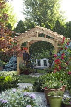 Arbor Ideas - Wooden arbor over a bench.