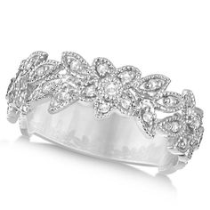 This diamond ring is budding with about 0.28 total carats. Emanating from 34 diamonds set into a stunning ring design of delicate flowers, this vintage style diamond flower ring is sure to delight.<p>Crafted from 14k white gold, each round shaped diamond is pave set into a lovely floral design that blooms with dazzling, reflective light.<p>This diamond flower ring is the perfect gift for any woman who loves diamond jewelry, perfect as a fashion ring, right hand band or brilliant cocktail…