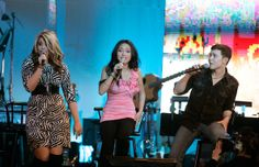Lauren Alaina, Thia Megia, and Scotty McCreery performed onstage during Muhammad Ali's Celebrity Fight Night XVII on March 19, 2011 in Phoenix, Arizona., top 11 week on 2011 American Idol.