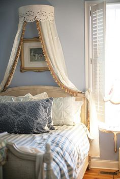 ooooh! I love the canopy crown and the shutters.  Paint color and wicker bed frame too.