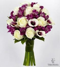 A hand-tied bouquet of white roses, purple Peruvian Lilies and bi-colored