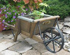 Create a rustic flower planter with an Amish wheelbarrow