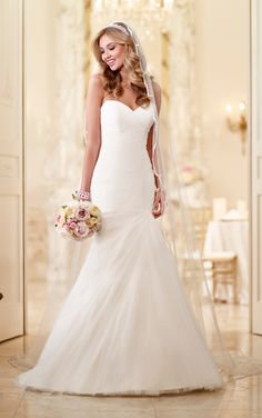 Look through wedding dresses by Stella York. Adequate boning, quality fabric linings, sewn-in bust cups and delicate interior elastic bands make this dress fit exceptionally well.