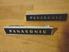 "2 vintage 70's panasonic speaker badge logo plate emblems - 2"" metal - japan from $9.95"