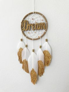 A personal favourite from my Etsy shop https://www.etsy.com/ca/listing/529873729/glitter-and-gold-dream-catcher-faux
