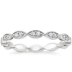 this is the wedding band i want.  18K White Gold Cadenza Eternity Diamond Ring (1/4 ct. tw.) from Brilliant Earth