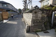 yanaka edo wall ca 1397 - like modern rammed earth or cob houses are made except including damaged roof tiles and damaged brick as well