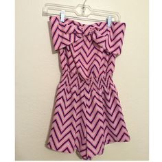 Chevron Romper Navy/bright coral, chevron romper. There is a fixed bow over the breast area(as pictured). Tops
