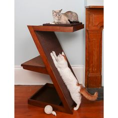Satisfy your cat's instincts to scratch and climb with this cat scratcher.