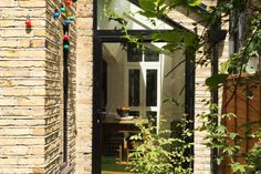 The kitchen on this Victorian terrace house has been extended to the side and the rear, creating a large kitchen/dining space and a small sitting area at the rear. Side Return Extension, Rear Extension, Extension Designs, House Extension Design, Kitchen Extension Layout, Small Sitting Areas, Victorian Terrace House, Steel Beams, House Extensions