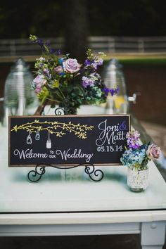 The branches and lanterns are adorable on this sign! #CedarwoodWeddings #CountryWedding #WeddingIdeas #WeddingPhotography #SpringWedding