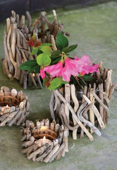 from at west end :: small driftwood cylinders with glass inserts for tealights, votives, or flowers