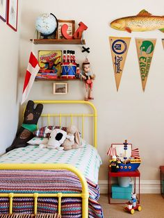 The most FUN boys room! Love all the eclectic images and banners hanging on the wall!