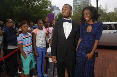 Students from Newark Collegiate Academy walk down their very own red carpet