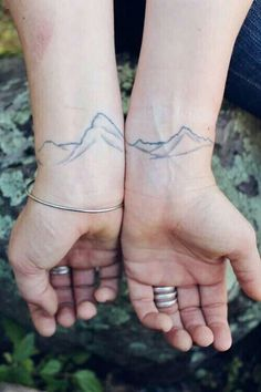 best friend continuous mountain range tattoo