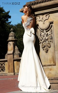 Stunning back crossover detail + bow + fit & flare silhouette + sweet train | Tarik Ediz 92092