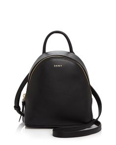 Carry this minimalist (and micro-mini) Dkny backpack as a crossbody or shoulder bag using the convertible strap option. Mini Backpack Purse, Mini Crossbody Bag, Small Backpack, Backpack Straps, Black Backpack, Stylish Backpacks, Girl Backpacks, Leather Backpacks, Minimalist Bag