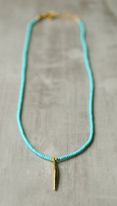 Turquoise Seed Bead Necklace with Long Gold Pendant by FlowDesigns
