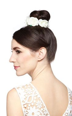 Trying to beat the heat but still rock the flowered look? ModCloth has you covered with this elastic hair tie that immediately adds elegance to whatever updo you create!