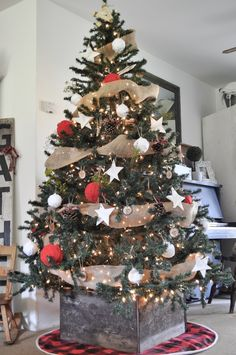 Build a rustic box for your Christmas Tree. It is easy and virtually free!
