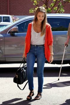 Keep it simple with high waisted skinny jeans and a colorful cocoon cardigan. In the fall, switch out the sandals for ankle boots.