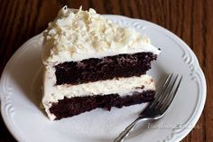 A layer of smooth, creamy cheesecake sandwiched between layers of rich, moist chocolate cake covered in a luscious cream cheese frosting.