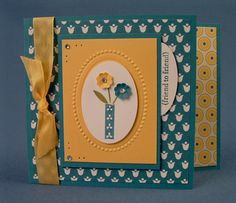 One of the cards for Hostess party Stamp set- bright blossoms, teeny tiny wishes Card stock- summer smooches dsp, daffodil delight, island indigo Ink- island indigo, old olive Big shot- designer frame embossing folder Accents- daffodil delight seam binding, rhinestones, paper piecer Punch- extra large oval, oval, itty bitty shapes