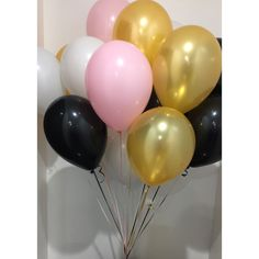 Gold, white, black and light pink helium balloons.