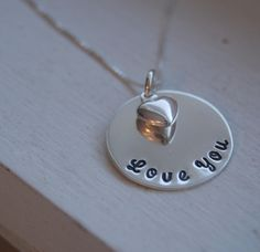 "Valentines Day Love You 3/4"" pendant with heart Personalized Hand stamped necklace Sterling silver. $42.00, via Etsy."