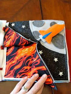 Quiet book rocket page idea.shows photos of finished book tells the child's response