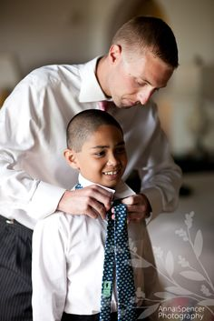 Anna and Spencer Photography, Atlanta Documentary Wedding Photographers. Groom helping his son with his tie before the wedding.