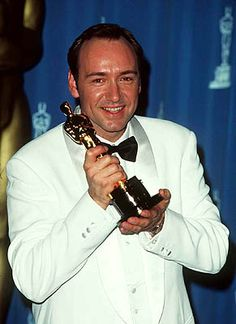 "Kevin Spacey backstage in the Press Room holding his Oscar for ""The Usual Suspects"" in 1996."