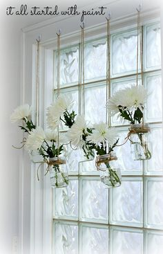 Mason jar window treatment!  What a great motivation to pick up fresh flowers!  And keep them safe from kitty munching!!
