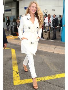 Blake Lively looked perfectly polished arriving to the Nice International airport in France on Monday – just two days before her movie is set to open the 2016 Cannes Film Festival.   Lively, who is expecting her second child with husband Ryan Reynolds, covered her baby bump with a white trench coat. She paired the look with matching pants and tan heeled sandals.