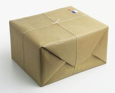 Brown parcel paper box, tied with string.