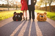 This couple used bear heads as props for their engagement photo shoot!