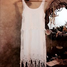 💋Ivory Crochet Dress💋 Stunning crochet dress in tiers of intricate detail with a distinctive hem design. Elegant yet simple, this effortlessly sexy pull-on sheath has a soft, camisole lining with adjustable straps. cotton. Hand Wash. Above the knee. Size xs 2-4  m(10-12) Boston Proper Dresses