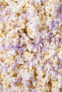 Fun white chocolate popcorn with purple sprinkles for the next movie night.