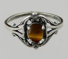 A Gorgeous Sterling Silver Filigree Ring Featuring a Beautiful Tiger Eye Made in America The Silver Dragon http://www.amazon.com/dp/B005FY8AC6/ref=cm_sw_r_pi_dp_7X-pwb1RHVAHK
