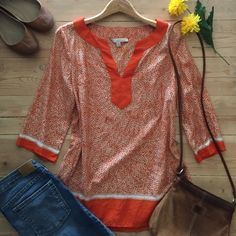 | Banana Republic Silk Blend Tunic Beautiful orange and cream tunic with 3/4 sleeves.  In excellent condition. Banana Republic Tops Tunics