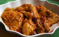 There are so many versions of Poulet a L'Haitienne, Chicken in Creole Sauce, or Poule en Sauce and many names for a simple chicken dish. In the Haitian culture it is very common for a dish to have several names depending on which part of the country a per Haitian Food Recipes, Stewed Chicken, Haitian Sauce Recipe, Haitian Bouillon Recipe, Easy Chicken Stew, Ginger Chicken, Pepper Chicken, Bbq Chicken, One Pot Dinners