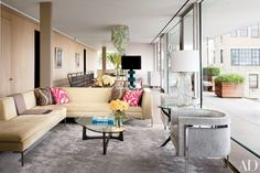 The penthouse features an open floor plan and tailored furniture.