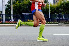 0adbdd2b8 feet athlete man running city marathon in compression socks