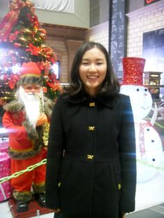 With mom ate dinner and did grocery shopping. In front of Christmas tree at the shopping center.