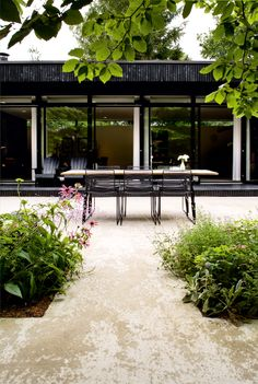 Simple and contemporary summer cottage in Denmark with stunning outdoor bathroom and gorgeous patio. Via bobedre.