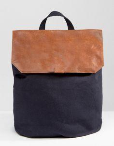ASOS - Sac à dos en toile avec dessus en cuir                                                                                                                                                                                 Plus