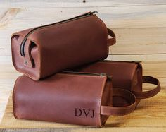 "Handmade leather bag, Dopp Kit, Toiletry Case, Travel kit. Handmade! Light brown. Buy 10, get 1 for free. We personalize the outside, please send the initials (first, middle and last, or first and last, or full name ) in the message or, in the ""comments section"" when ordering. Dimensions: Medium 20*10*10 cm / 7,9 4 4 Big 23*10*11 cm / 9 4 4,3 Designed and handcrafted in Ukraine. Shades of leather may be different from photo. DELIVERY We make your item and ship your package in 5-..."